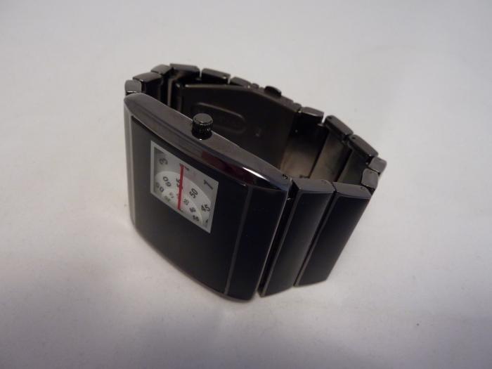 Solid stainless fold over adjustable segment bracelet.