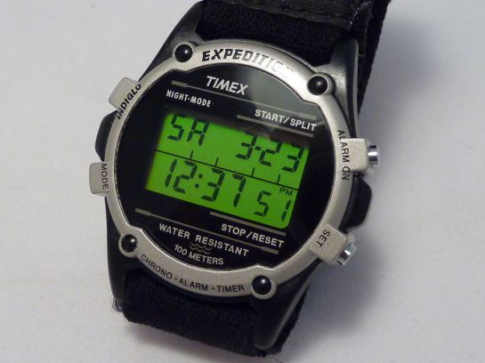 Timex digital display in reflecting light - gives fluorescent contrast