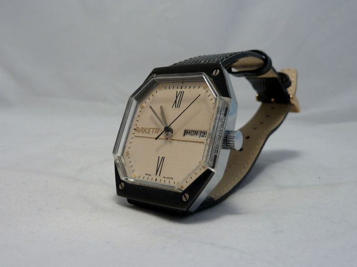 Unusual textured face and octagonal case, Day and Date watch.
