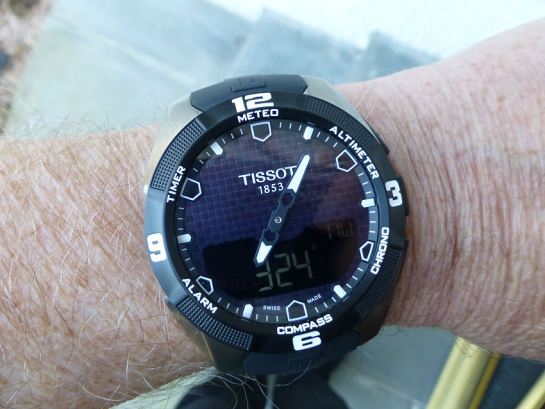 Compass mode - Hands become True North pointer.  The digital display indicates angle in degrees between the 12 o'clock and the True North pointer. Declination can be set in menu.