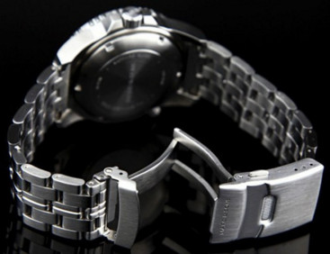 Screwed Stainless Steel back , 300m Water Resistance and decent bracelet, shows quality.