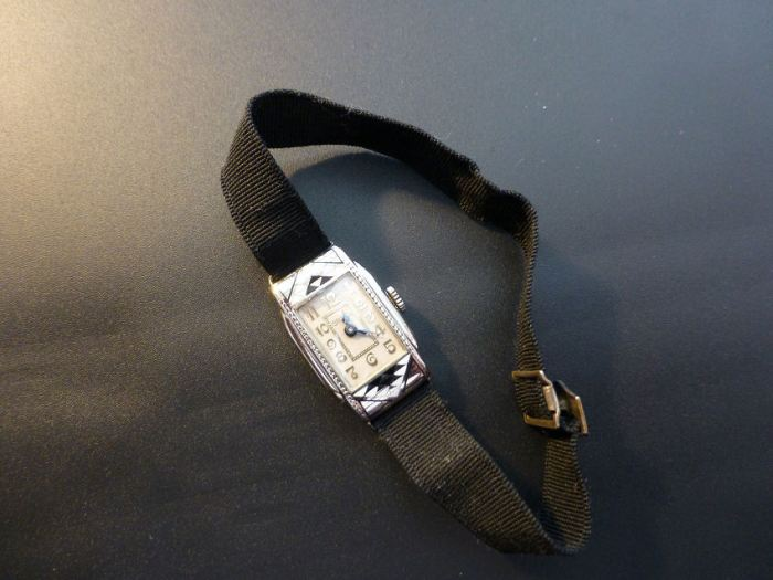 Original strap and slide clasp.
