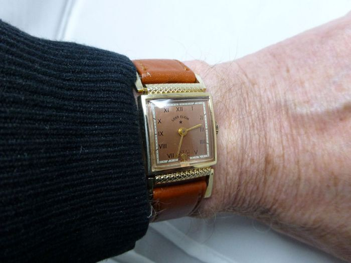 On the wrist looks bigger than it is owing to the extended hinged lug arrangement.